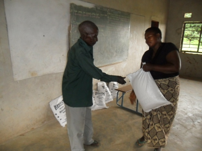 Mrs Mugala giving melie meal to one of our clients in Mugala community