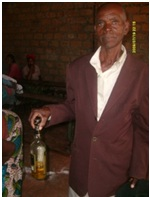 Moses Mwango receiving cooking oil in St. Anthony community