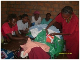 Catherine sorting out clothes in readiness for distribution to the patients