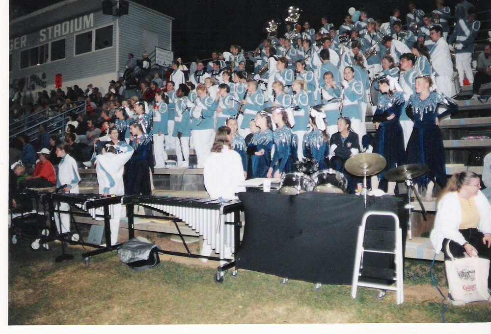 Marching band, football game, I think 10th grade? There I am toward the middle, I'm looking at the camera, the one on the end playing clarinet.