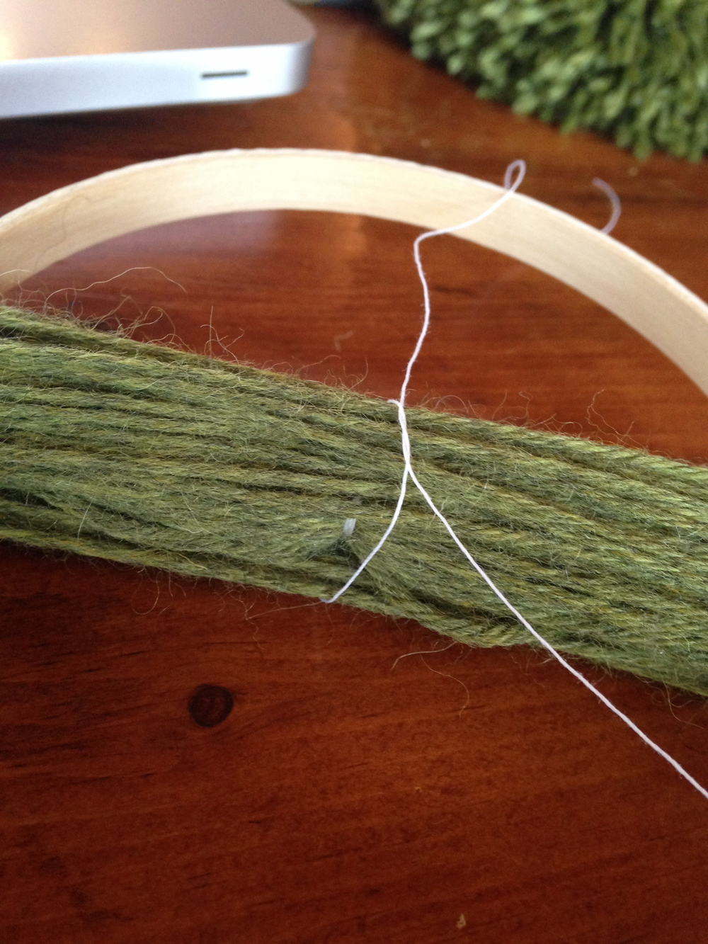 look closely at the center of the yarn and you can see where the first section of yarn has been tied tightly with heavy thread.