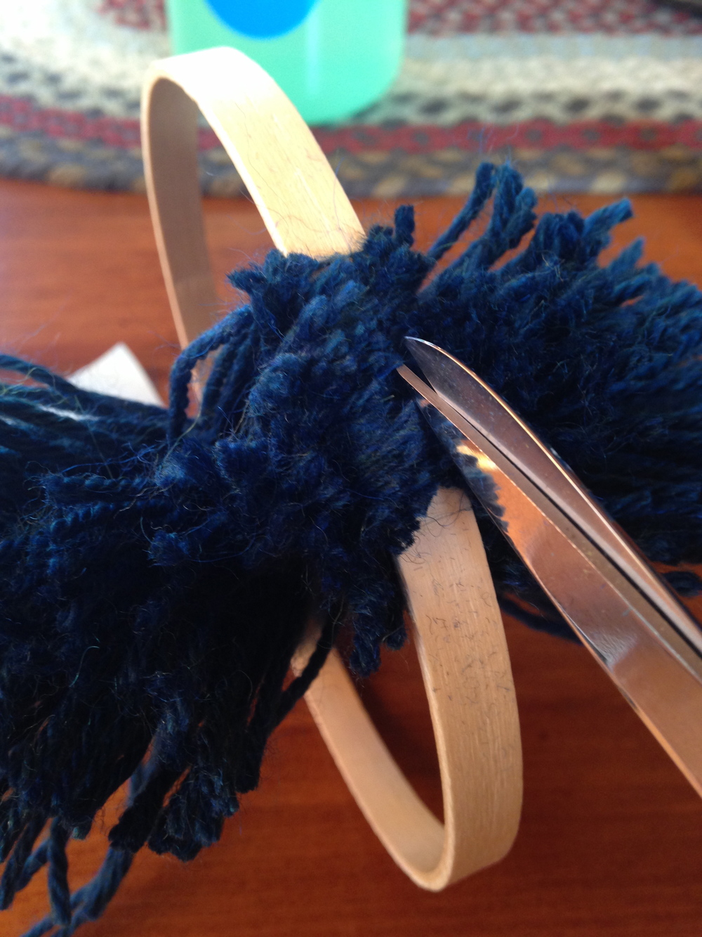 Here is where your sharp scissors comes into play as you cut through all that yarn!