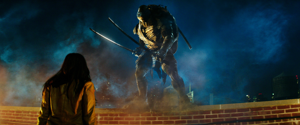"Leonardo and April O'Neil (Megan Fox) in Paramount's ""Teenage Mutant Ninja Turtles"" (Courtesy Paramount Pictures)"