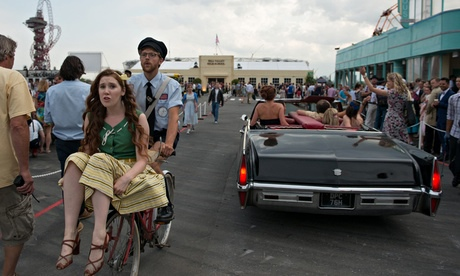 The people of Hill Valley bustle about their business as everyone waits for the sun to set. (Courtesy of The Guardian)
