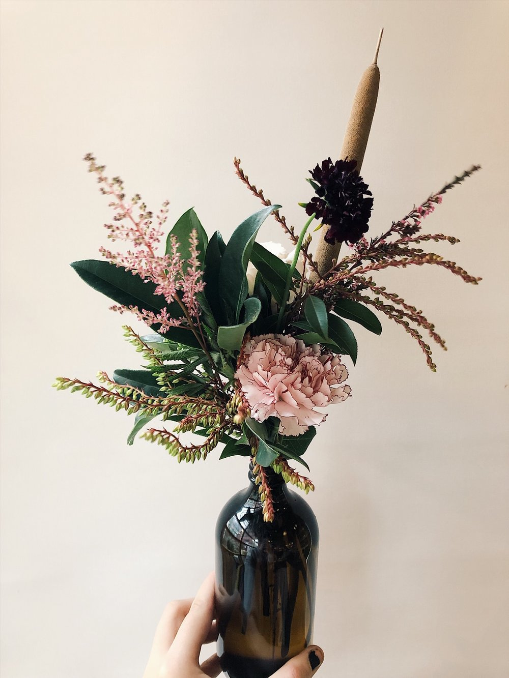 small bottle carnation arrangement