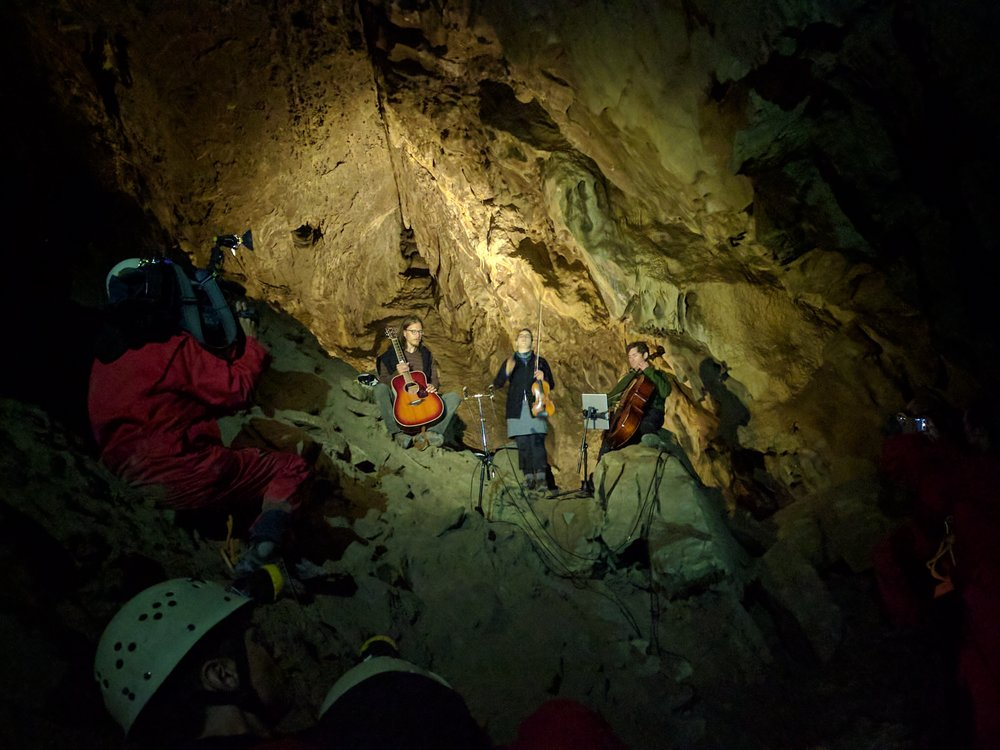 Raine performs in The Rat's Nest Cave near Canmore, 10 stories below the Earth.