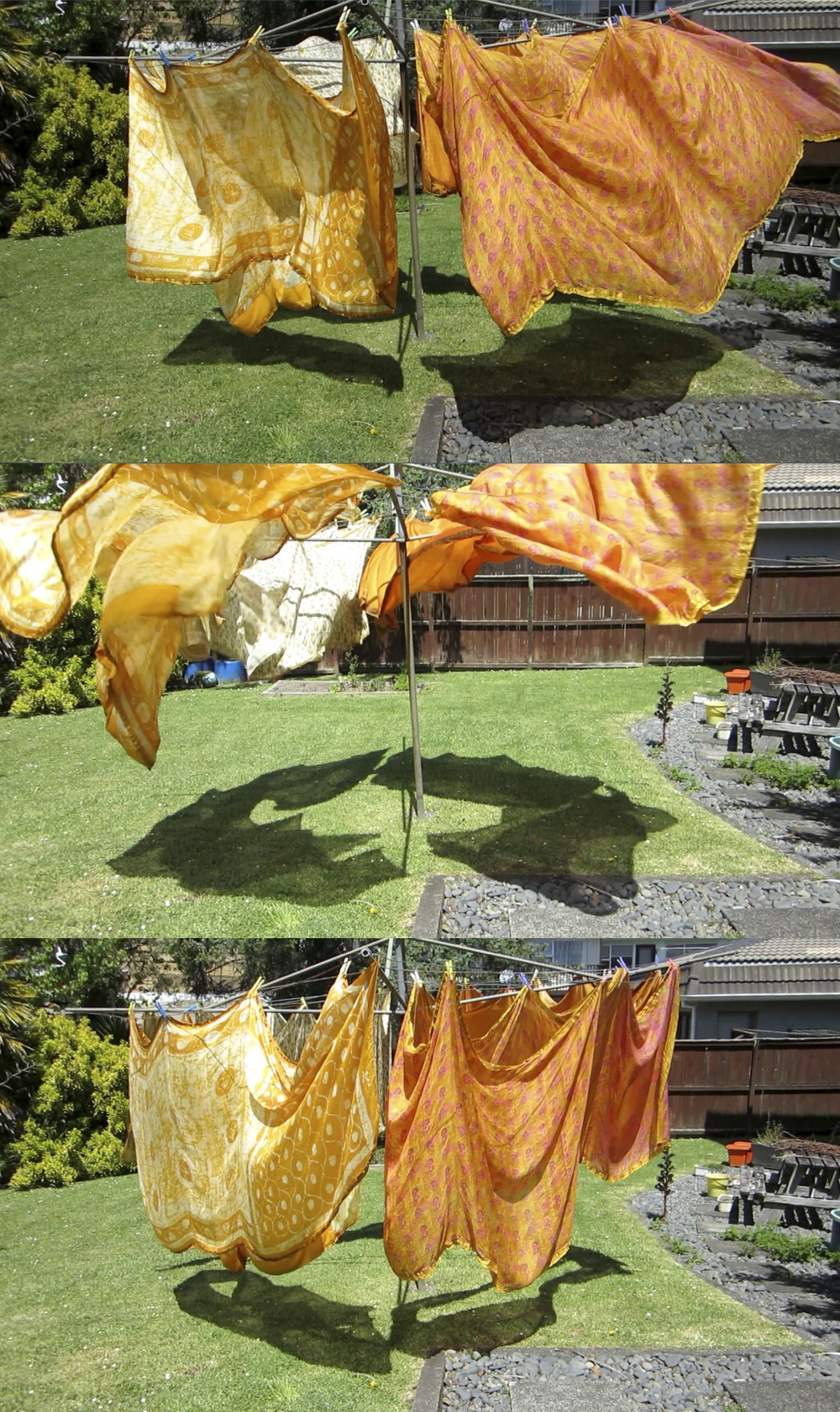 Brydee Rood, Wind Drawing Sunday, 10.11.2013 14:06, (still), Original HD video loop [duration 15:54] Site specific drawing with wind, vintage silk sarees and rotary washing line.