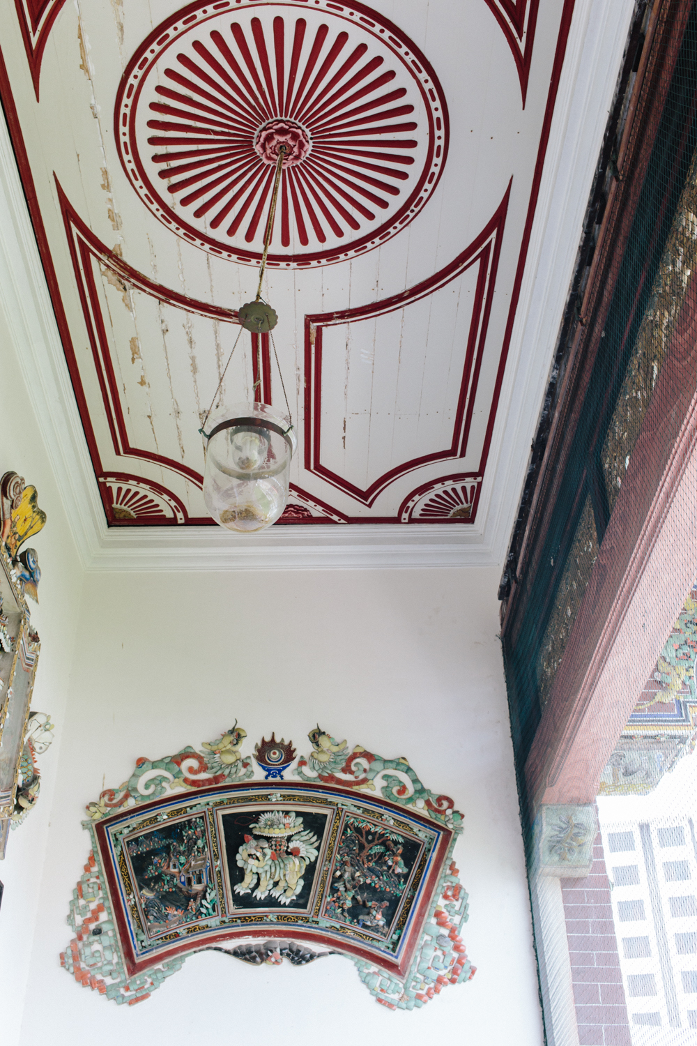 Ceiling details and one of many works of art that depict Chinese mythology.