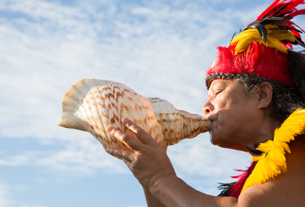 Traditional Polynesian welcome with harmonies from a conch shell at Fa'a'ā International Airport upon French Bee's inaugural flight from Paris > SF > Tahiti.