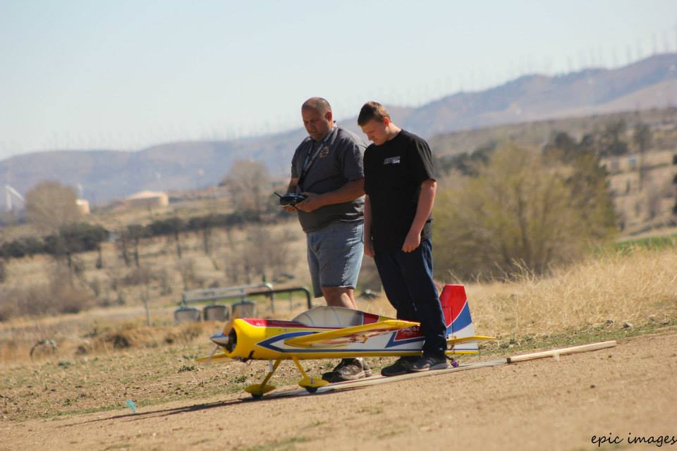 Father & Son demonstrate excellent flying skills before an audience of enthusiastic learners.