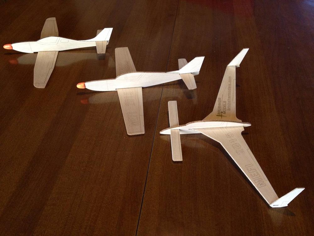 "Left to right: Lancair Legacy, Glasair, & Rutan Long EZ ""chuck"" gliders, MEFI 2015"