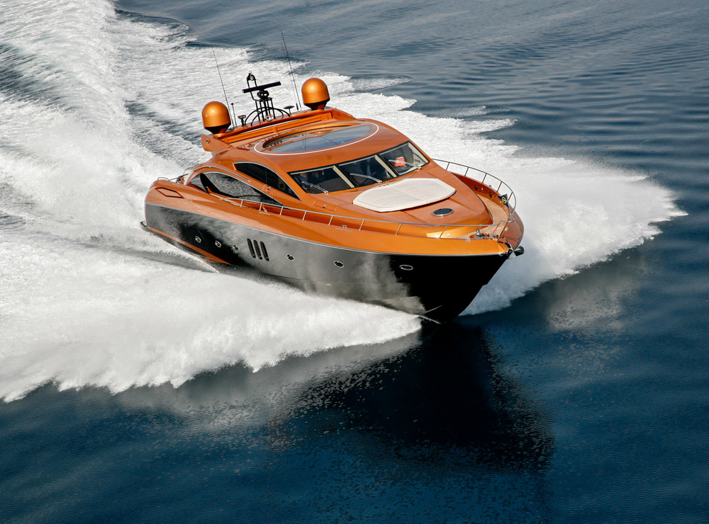 Golden yacht glides over the surface of the sea.jpg
