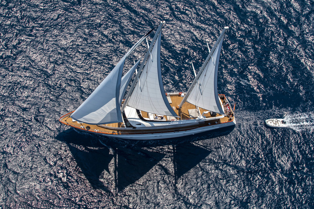 cruising yacht with sails and shade sails at sea.jpg