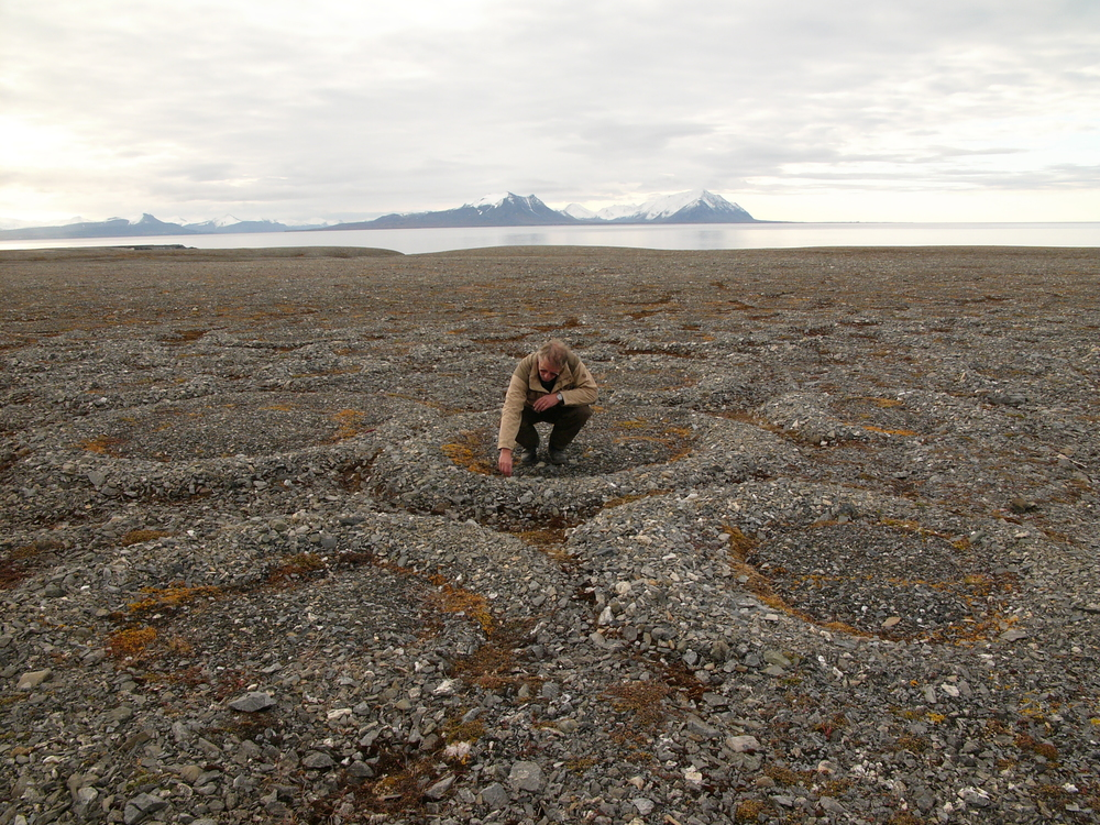 Partially melted and collapsed lithalsas (heaved mounds found in permafrost) have left circle-like structures on the Svalbard Archipelago (Wikipedia)