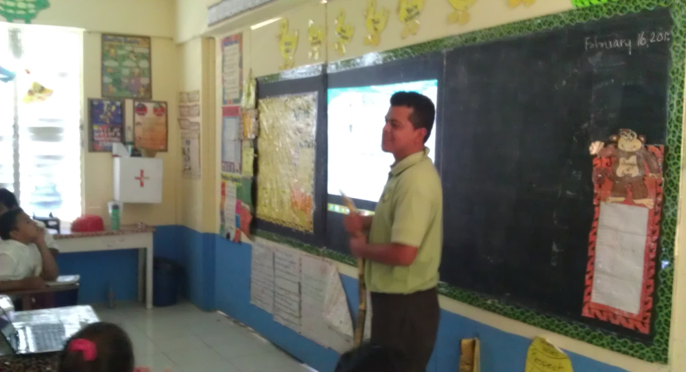 Luis Gongora, Field Officer, giving a presentation at Louisiana Government School in the Orange Walk District