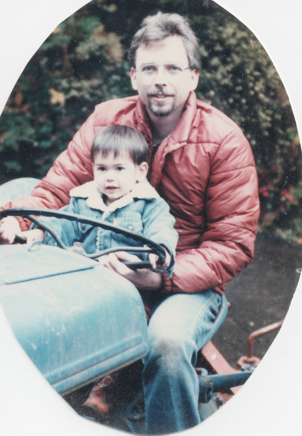 Sage & his dad. Getting an opportunity to drive the tractor!