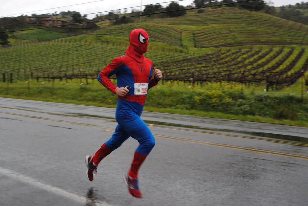 If you race in a spiderman suit you can definitely fly under the radar!  Yeah did we mention that Ian also at one point had the Guinness Record for the fastest marathon time ever recorded in a superhero costume