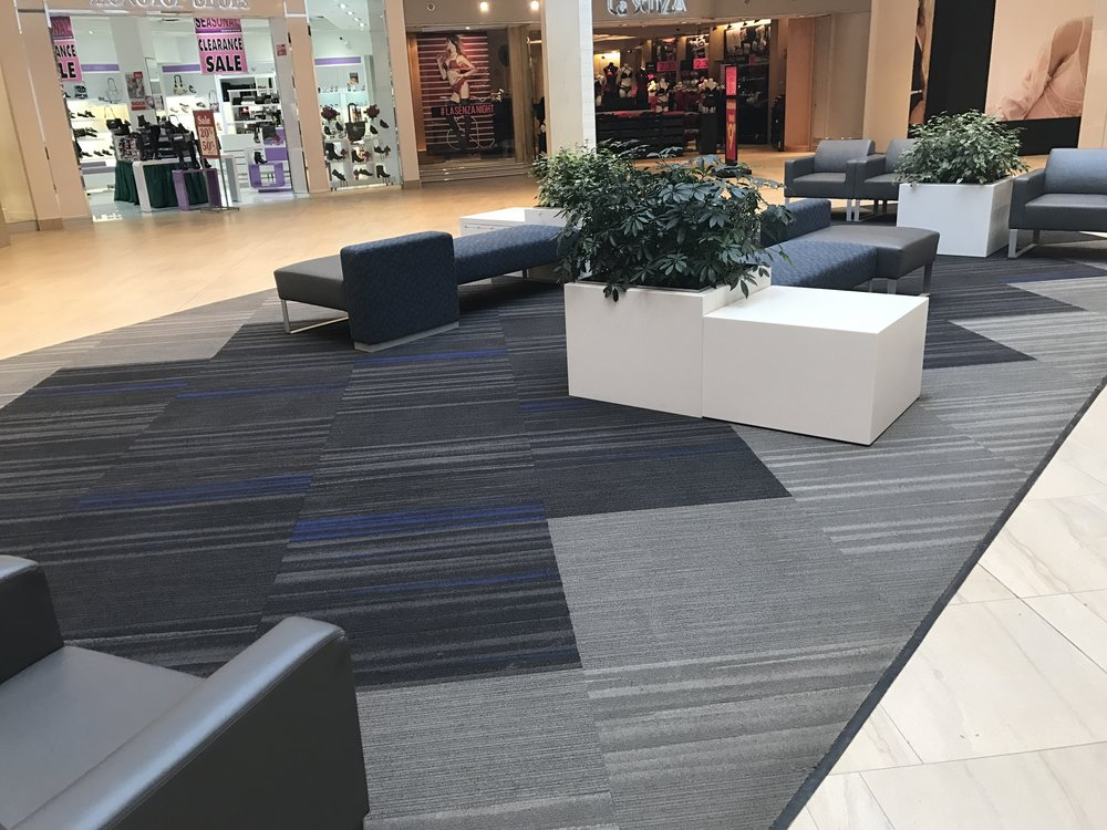 Shaw carpet tile with applied edging for seating areas all over the mall