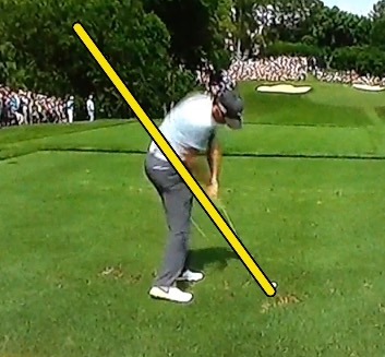 Rory McIlroy also staying in posture through impact with his right arm close in to his side
