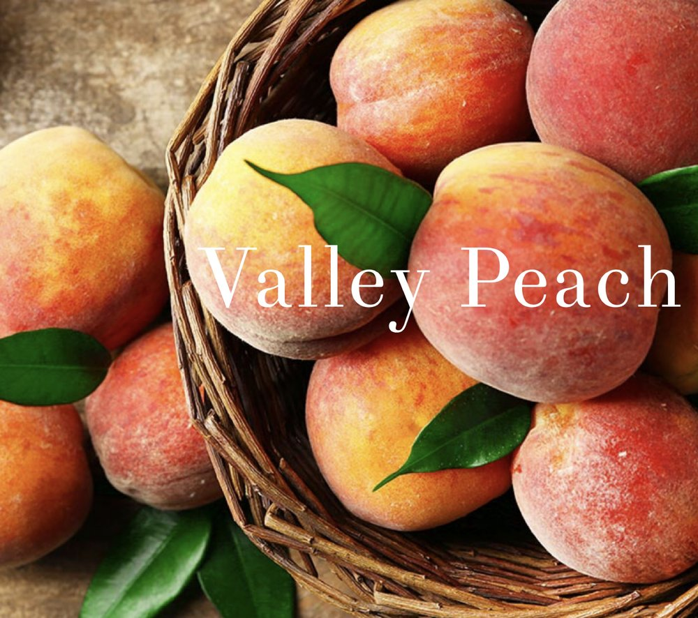 The scent of freshly picked orchard peaches.