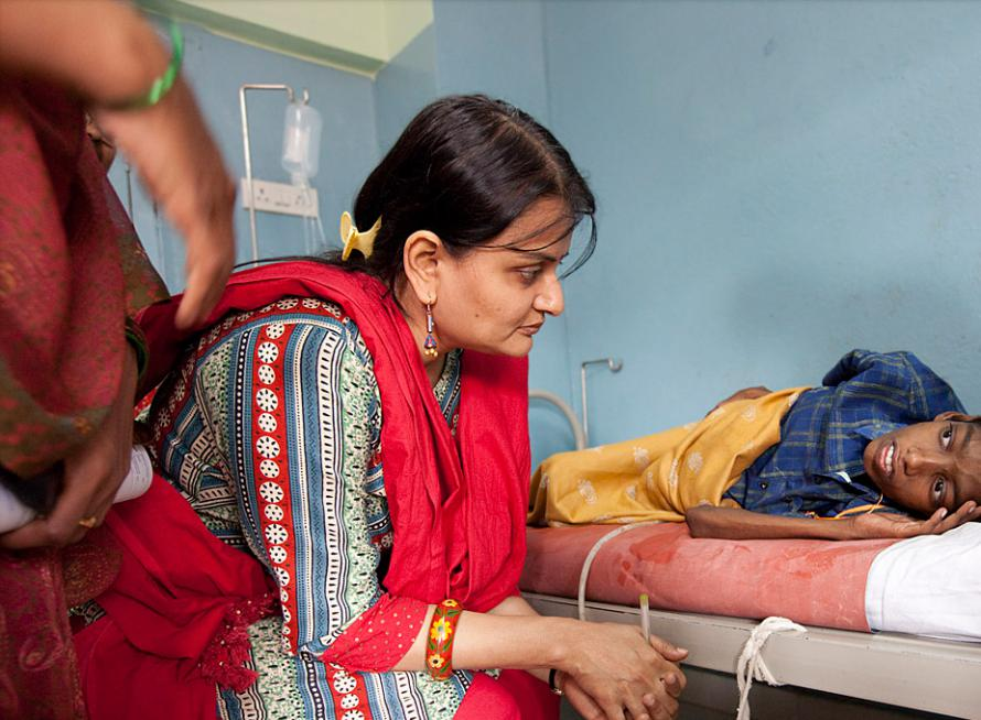 Dr. Gayatri Palat, director of palliative care, talks with Suresh during her rounds of the paediatric ward.