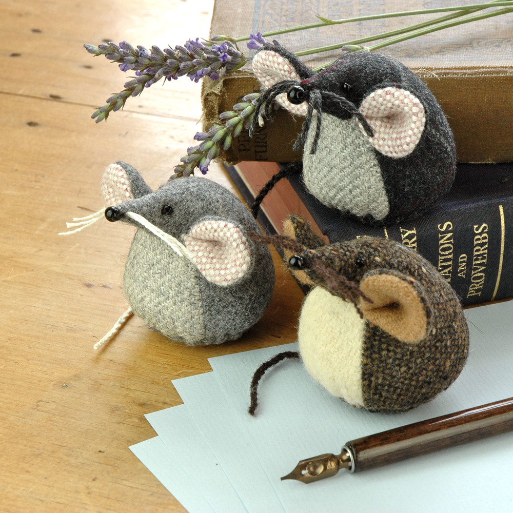 Handmade tweed mice paperweights.