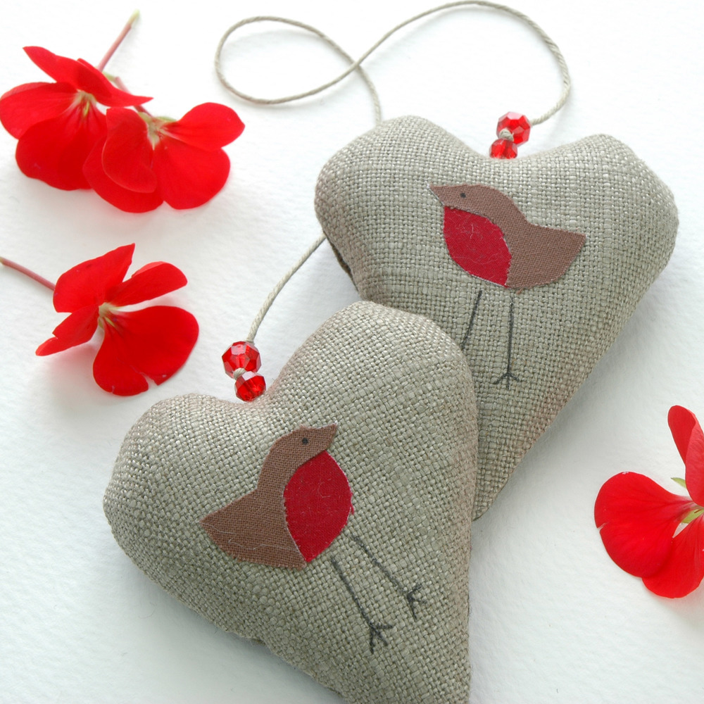 Handmade lavender filled hanging hearts with a robin motif.
