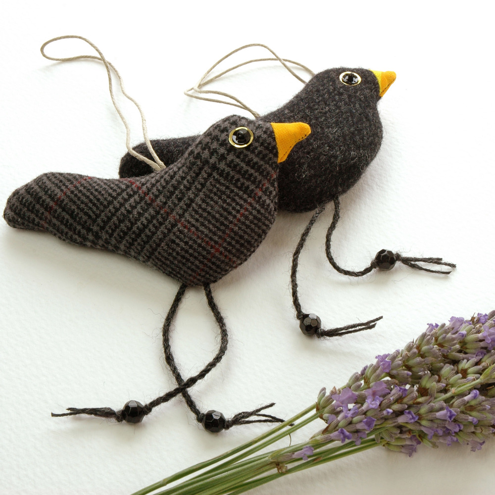 Handmade tweed hanging black birds.