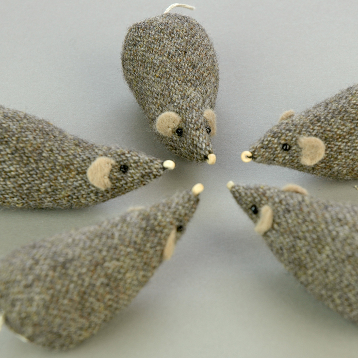 Handmade tweed shrew paperweights.