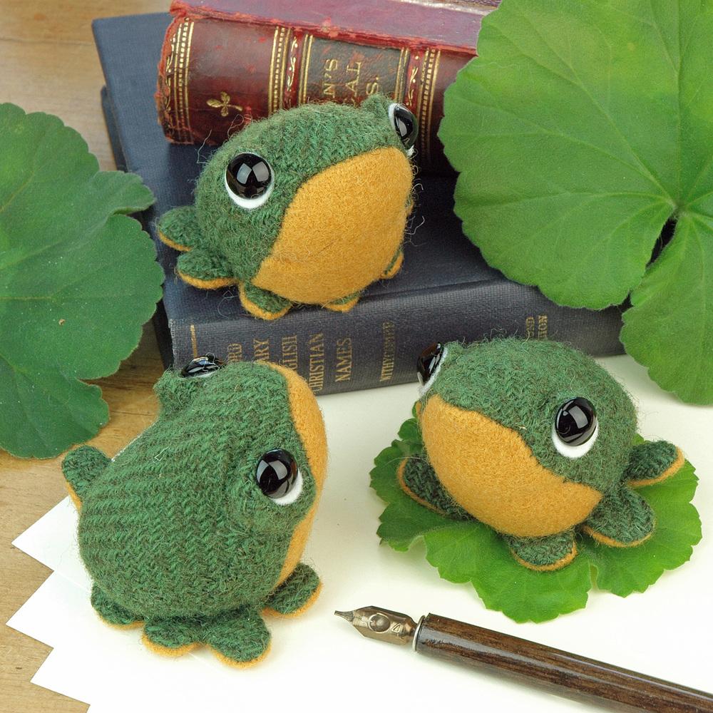 Handmade tweed frog paperweights.