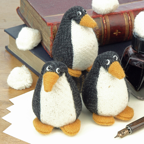 Handmade tweed penguin paperweights.