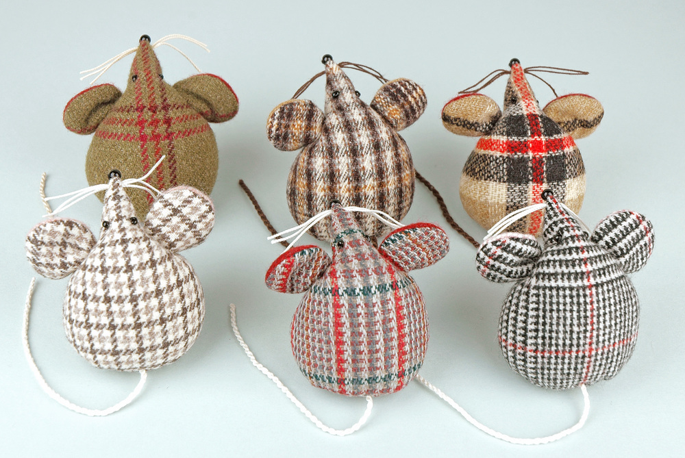 A group of handmade tweed tartan mice paperweights.