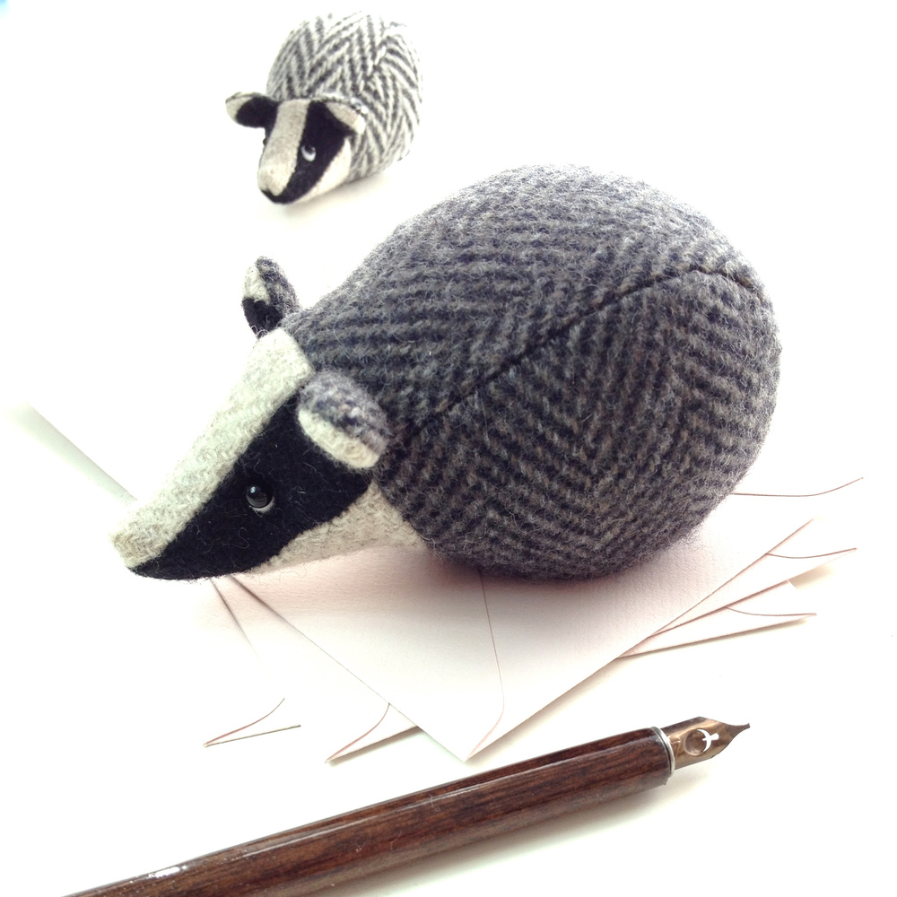 Handmade tweed badger paperweights.
