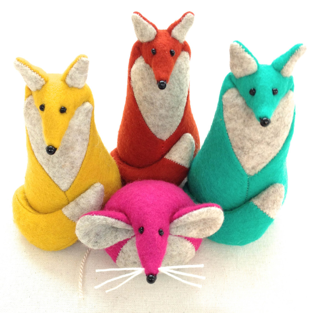 Handmade wool felt foxes and a mouse paperweights.
