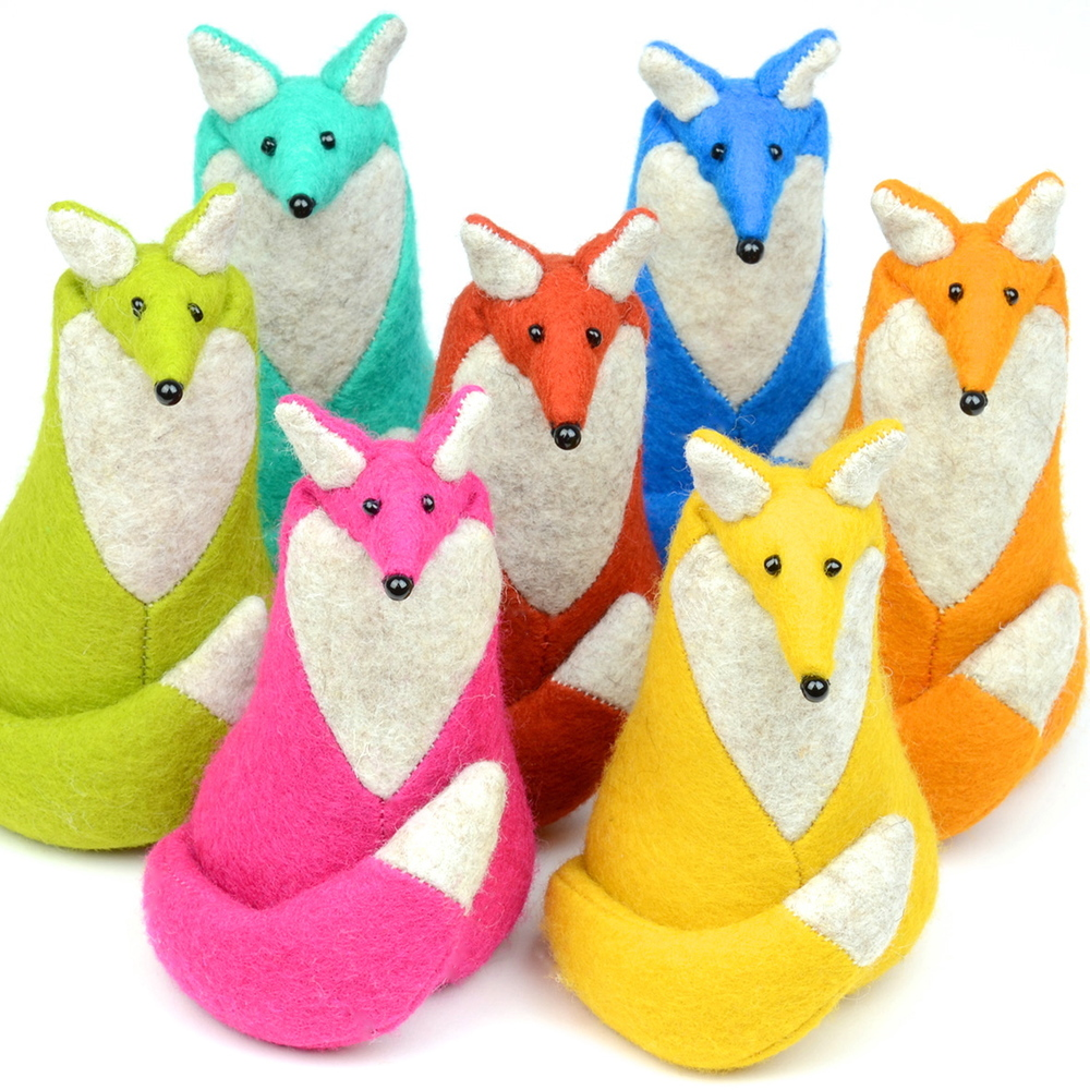 Colourful group of handmade felt fox paperweights.