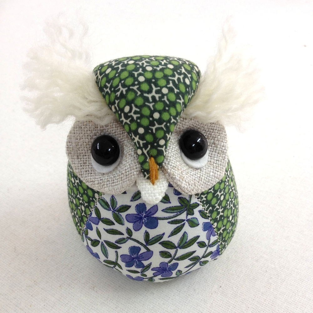Handmade owl paperweight in vintage Liberty print fabrics.