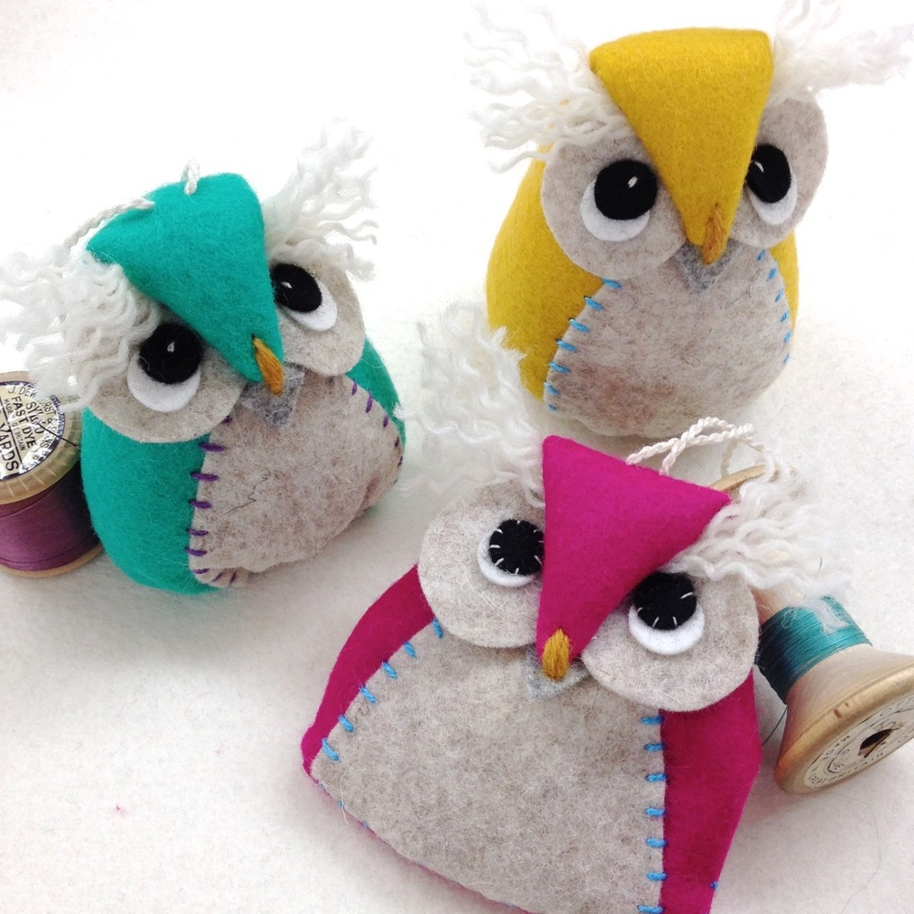 Handmade wool felt owl hanging decorations based on the Bilberry Woods character Ollie the Owl.