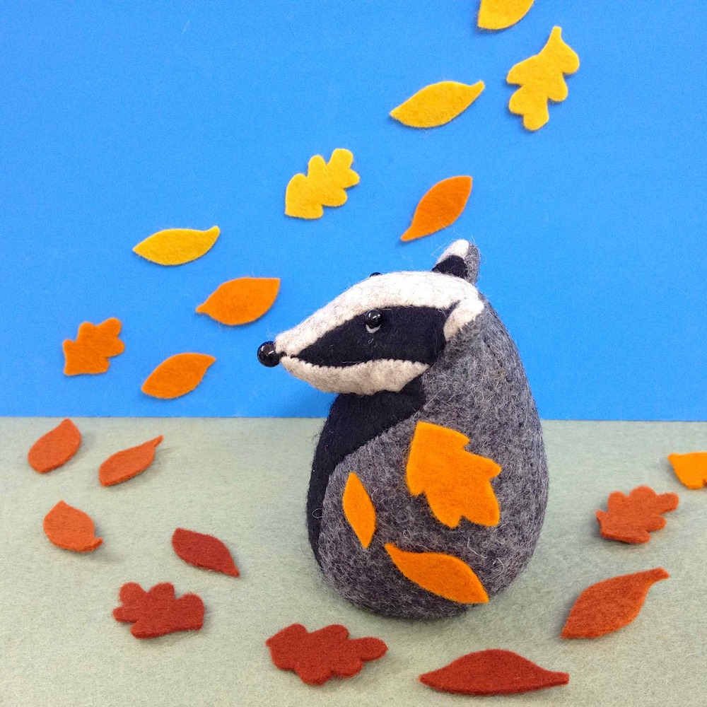 Handmade Bernard the Badger having a walk in a windy day.