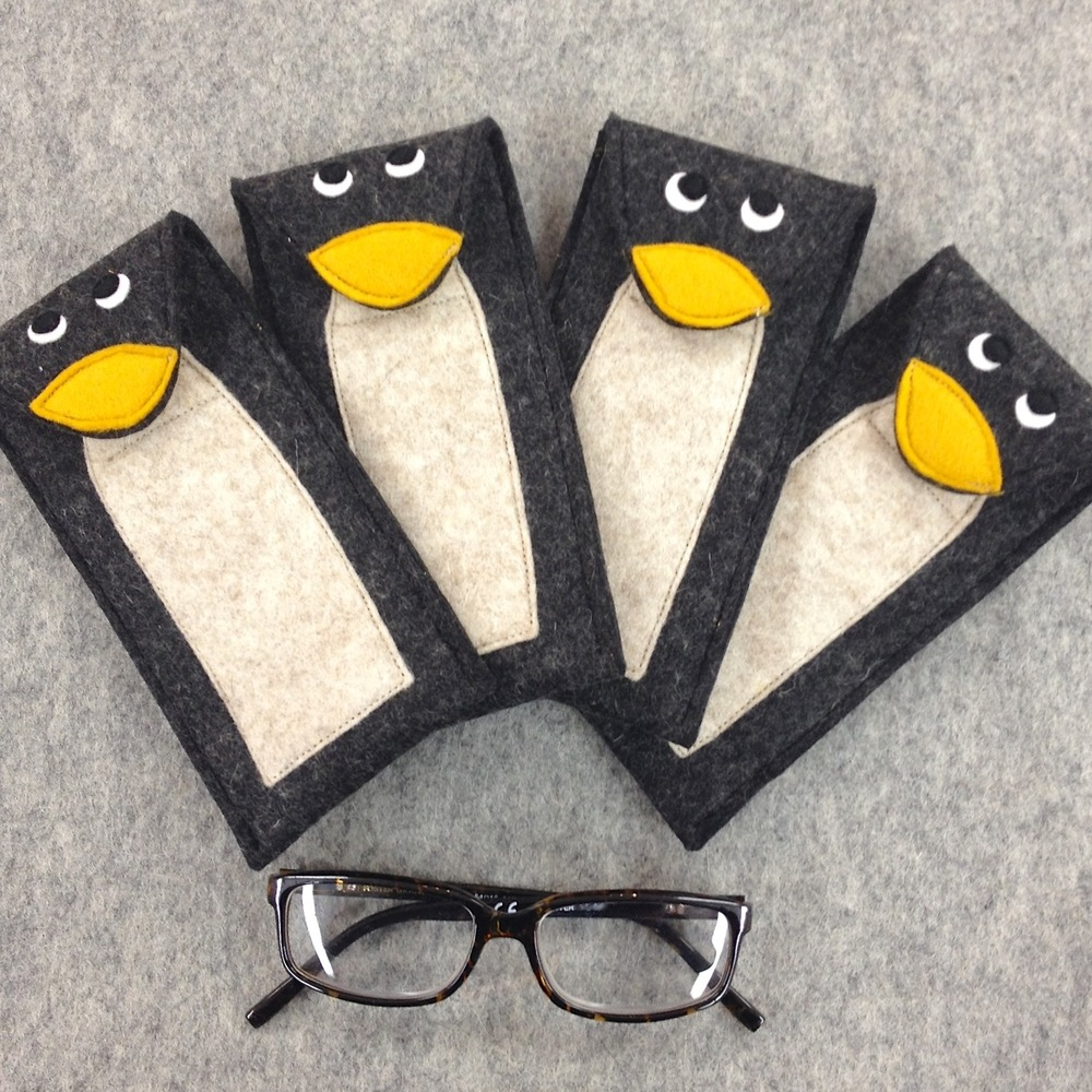 Handmade Pedro the Penguin glasses case in wool felt.