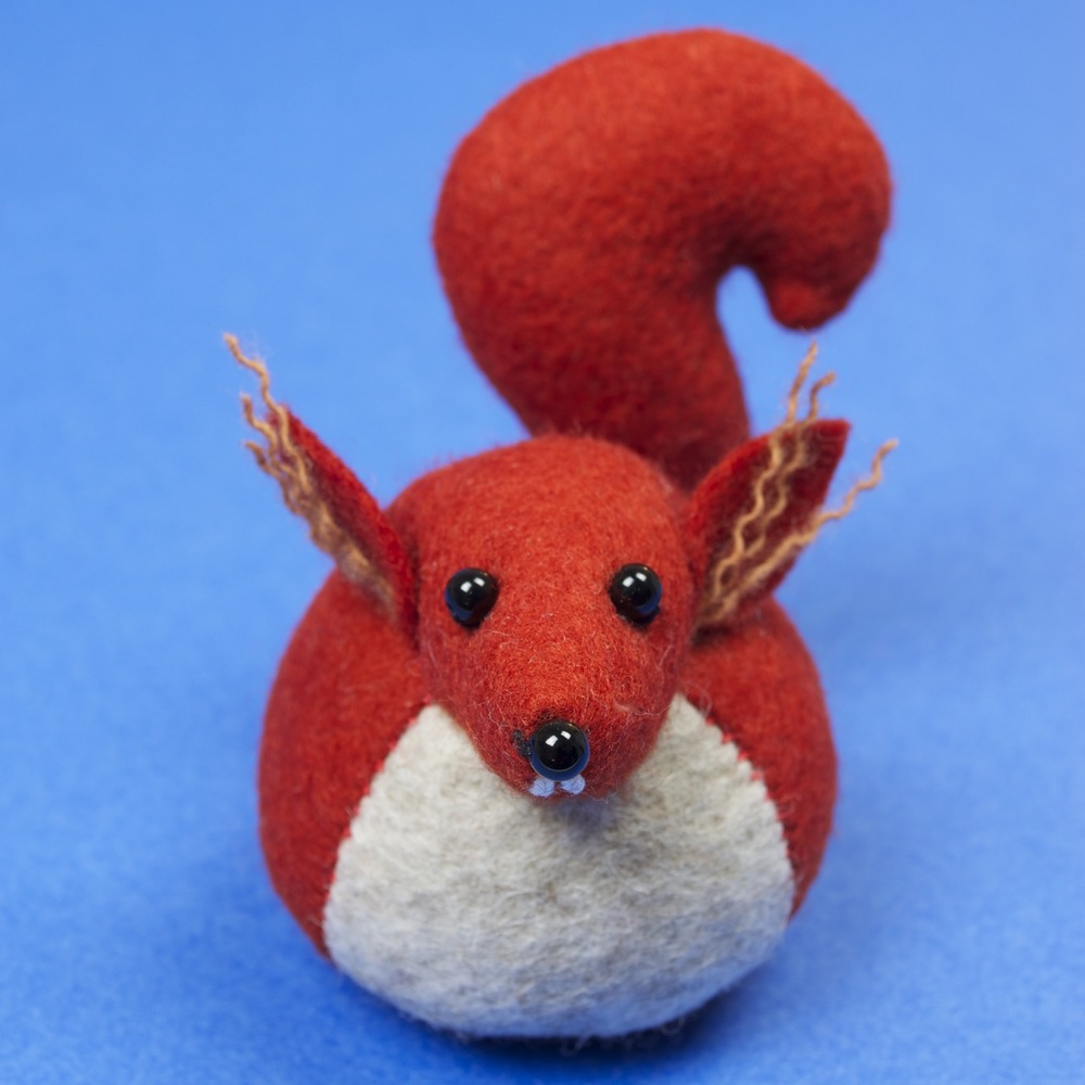 Hemingway the red squirrel felt soft sculpture paperweight.