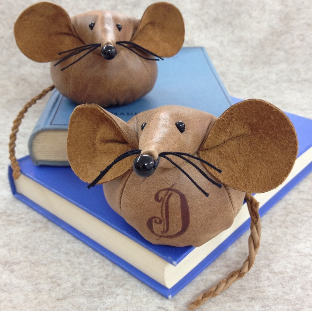 Handmade natural leather mouse paperweight.