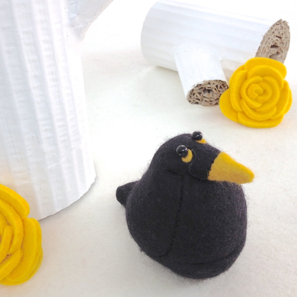 Handmade Billy the Blackbird felt paperweight.