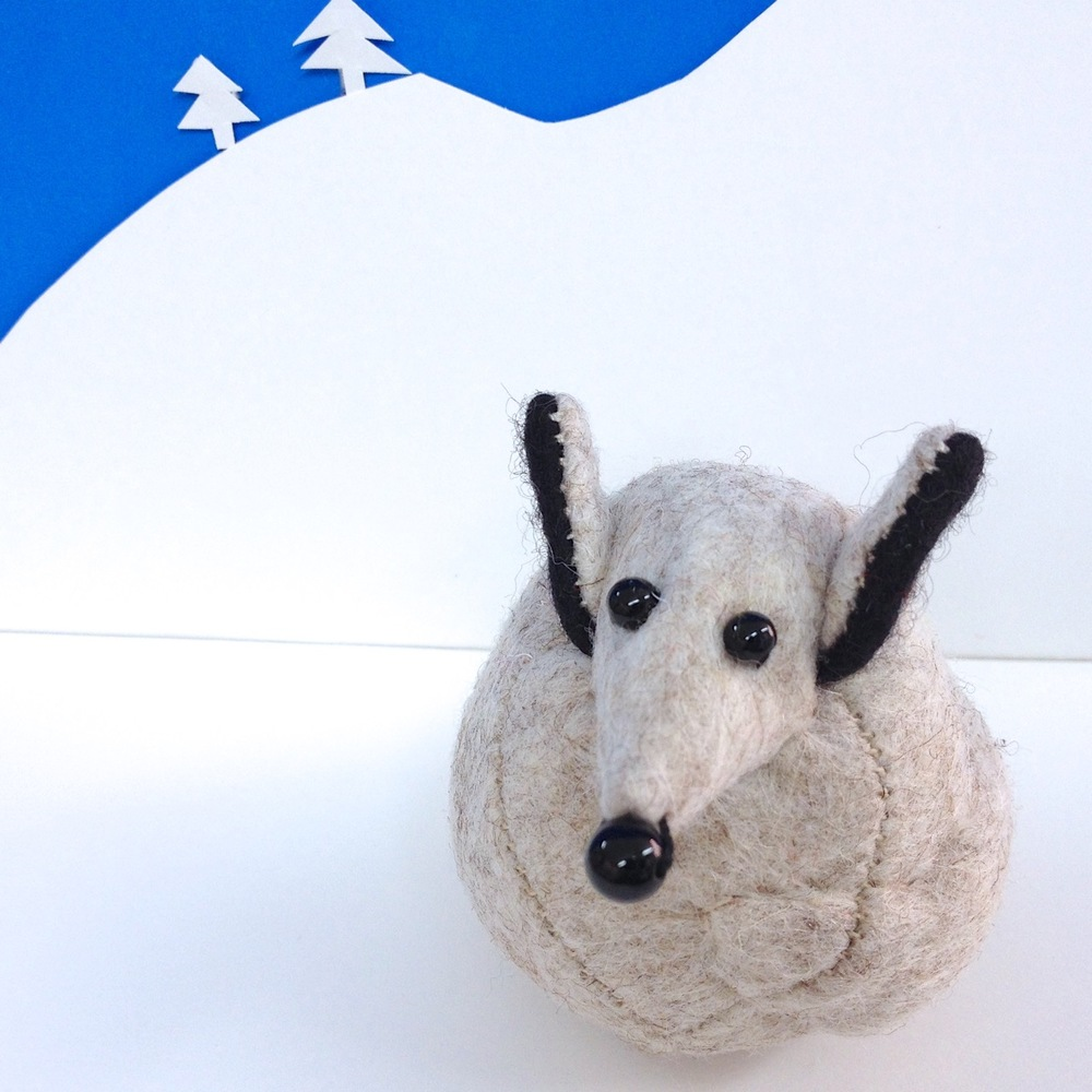Fleming the Arctic Fox paperweight, handmade from felt and weighted with steel.