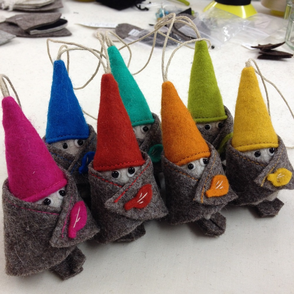 A group of handmade Bilberry Woods hanging dwarfs/gnomes.