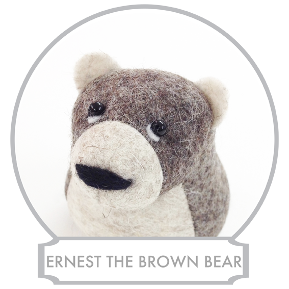 Ernest the Brown Bear  is a very contemplative bear, yet not a very talkative one. He seems to be living in his own world most of the time, but once you get him talking it becomes very clear that he holds a world of knowledge and wisdom and that he lives in realm where the reality and myths blend together and where legends are only history forgotten.  READ MORE >