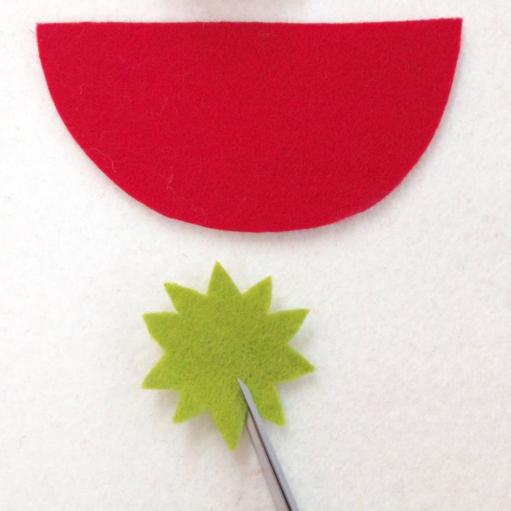 Cut pieces from felt. Snip with tips of the scissors to create leaves.