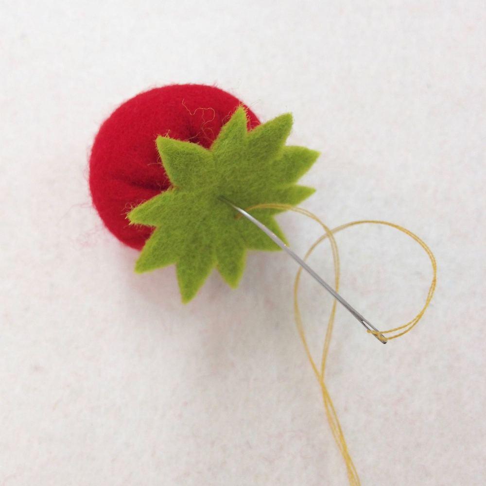 Add strawberry leaf with a stitch.