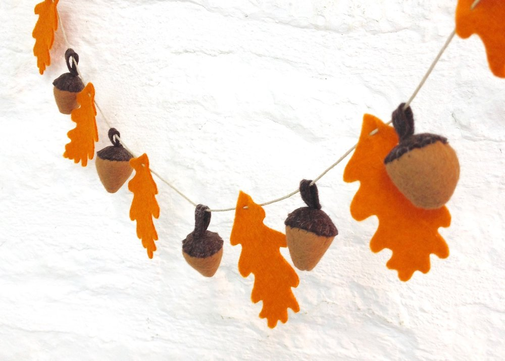 Felt acorn and oak leaf garland autumn decoration.