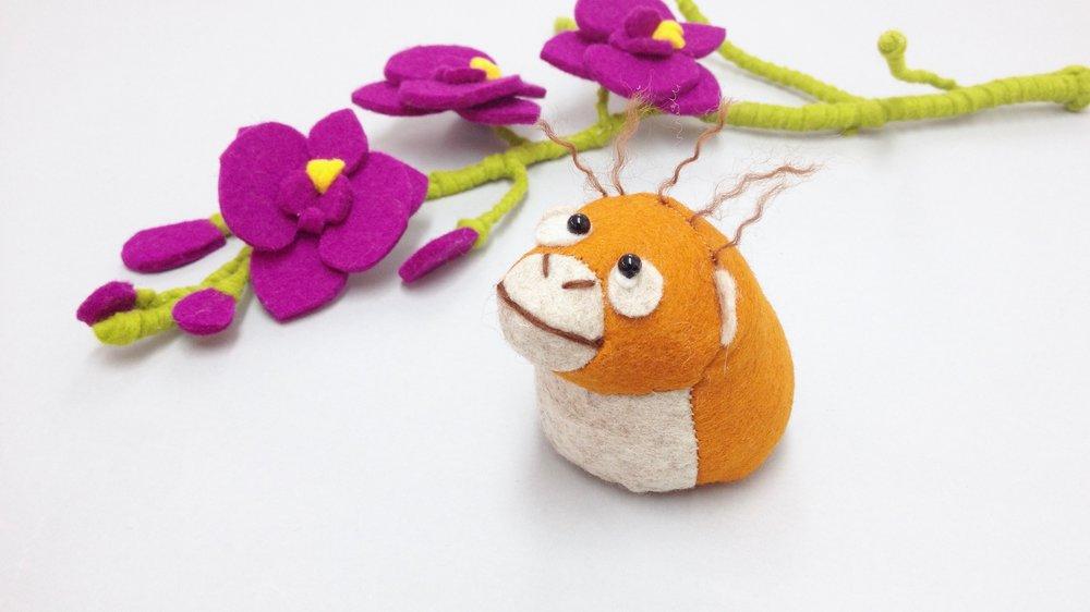 Bilberry Woods storybook character Oscar the Orangutan handmade from wool felt by Laura Mirjami   Mirjami Design.