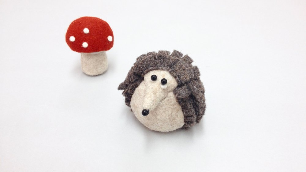 Bilberry Woods storybook character Hartwig the Hedgehog handmade from wool felt by Laura Mirjami | Mirjami Design.